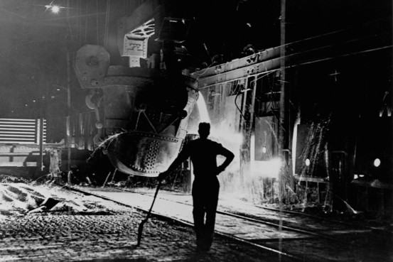Hot metal from the Blast Furnace being poured into the steelmaking Open Hearth Furnace - 1950s