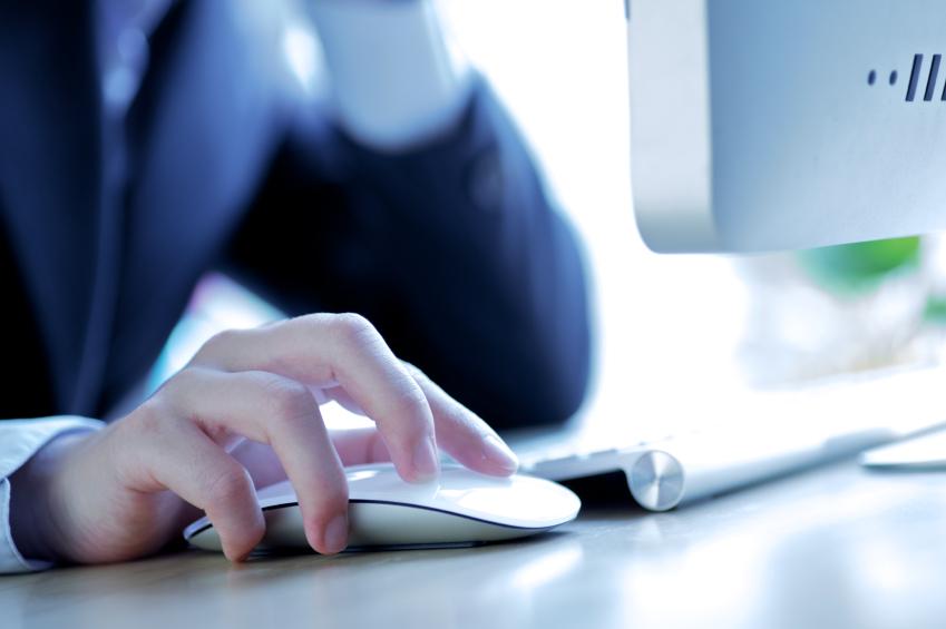 businesswoman using desktop computer.jpg