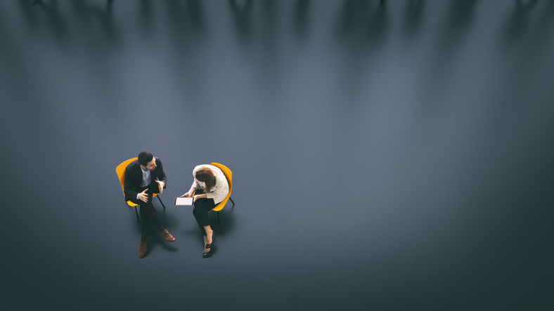 Overhead view of two business persons in the lobby - Stock image.jpg