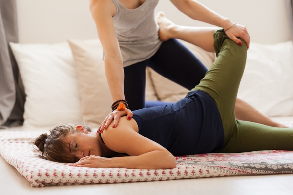 Thai Yoga stretch for quads and psoas.