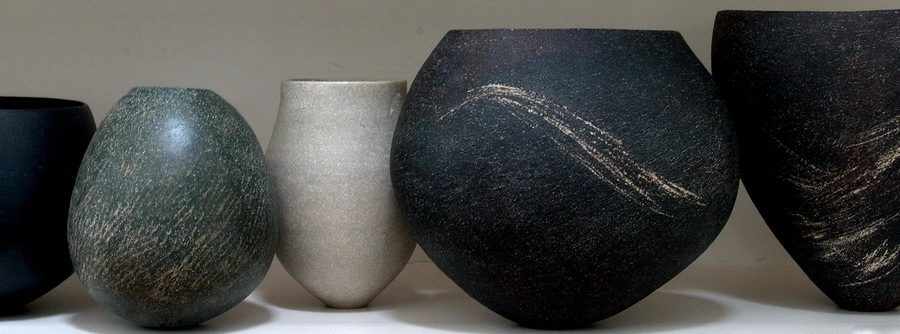 High-fired stoneware with an admixture of oxides or stains and sgraffito decoration.