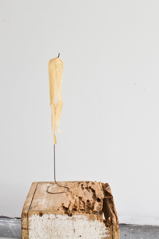Untitled | Polyurethane, fabric, steel, found wood box, 2017