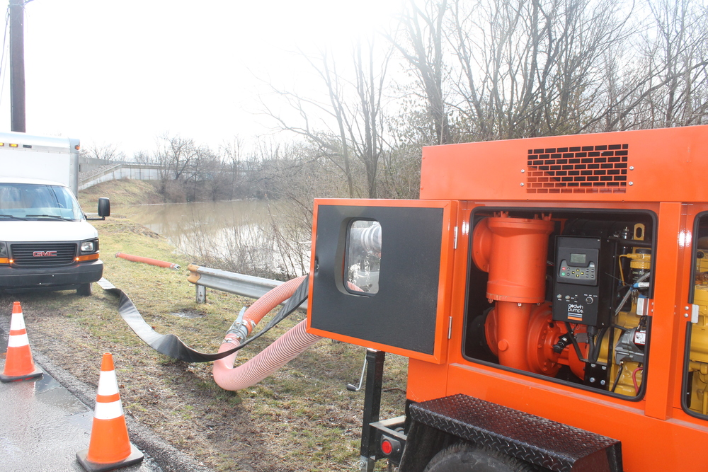 A city water pump helps alleviate the flooding.