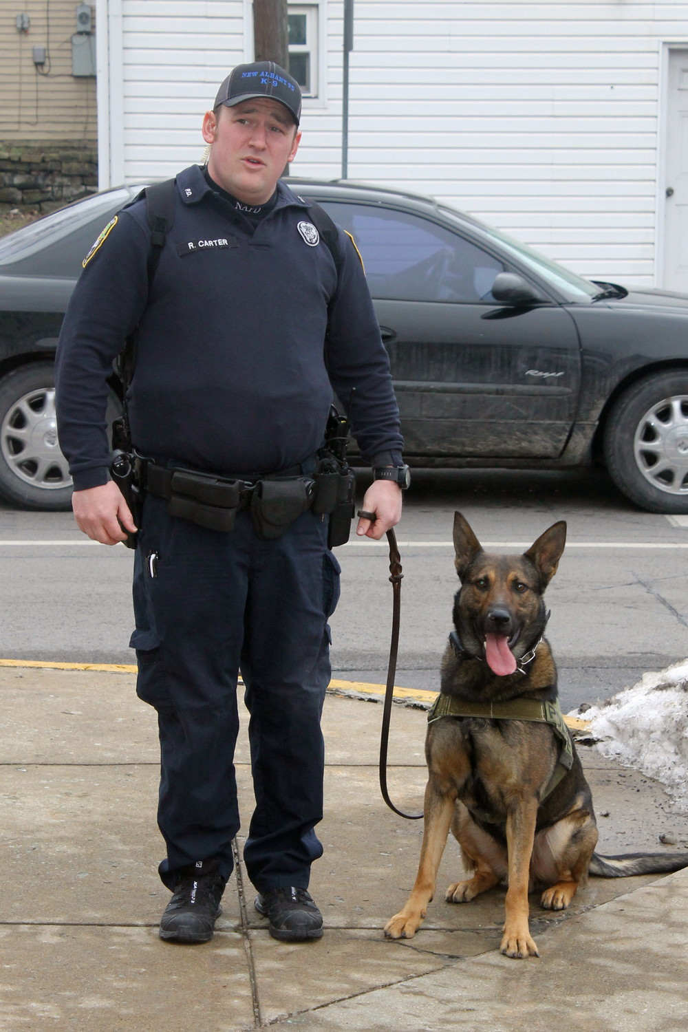 Patrolman Robert Carter and Warro outside the New Albany Police Department.