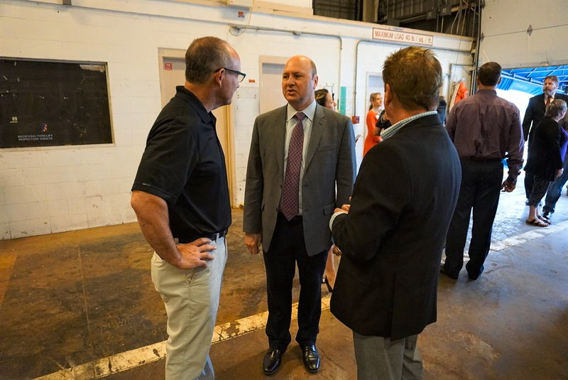Mayor Gahan speaks with Jeff Conder, Vice President of Manufacturing for Sazerac Co., and Matt Hall, Executive Vice President of One Southern Indiana.
