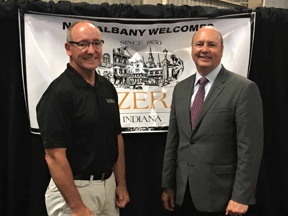 Jeff Conder, Vice President of Manufacturing for Sazerac Co., with Mayor Gahan.