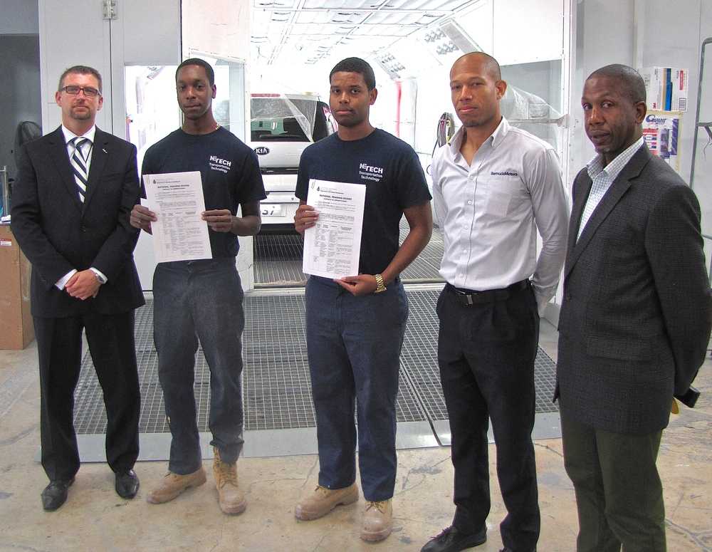 From left: Home Affairs MInister Michael Fahy, apprentices Tyree Armstrong and Jabari Hollis, Atinori Butterfield of Bermuda Motors, and Kenneth Bartram,   Training and Assessment Officer of the  Department of Workforce Development.