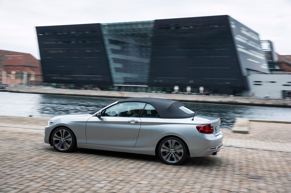 2015-bmw-2-series-convertible-rear-side-in-motion.jpg