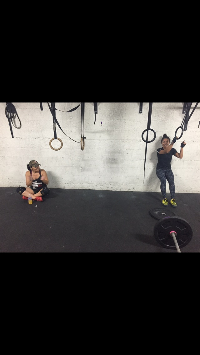 The Silver Fox & Jenn just hangin out in there happy place post WOD!