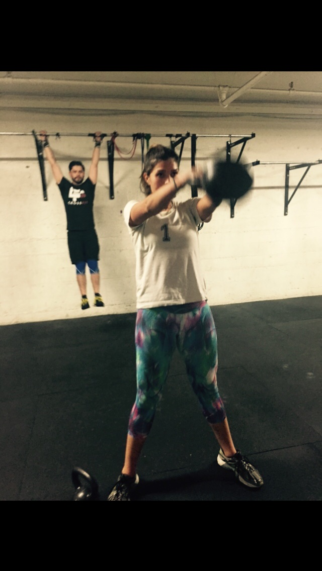 Gaby doing them KB swings with Roger getting yoked in the background!