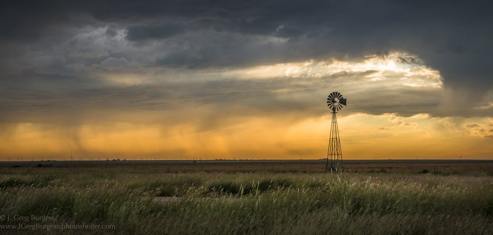 Light Rainshower and Windmill in the Sunset
