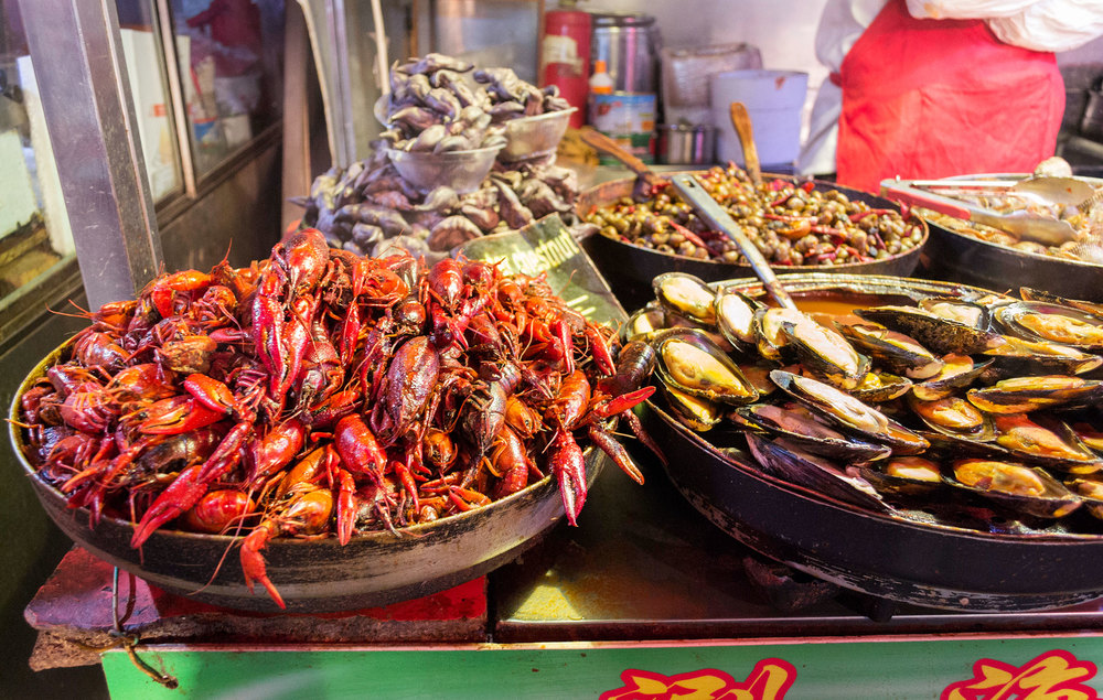 Sichuan peppers and hot chili-sauce covered crawfish is a very popular dish in China. Seafood is readily available in eastern China and crawfish has been heavily exported to the United States in the past.