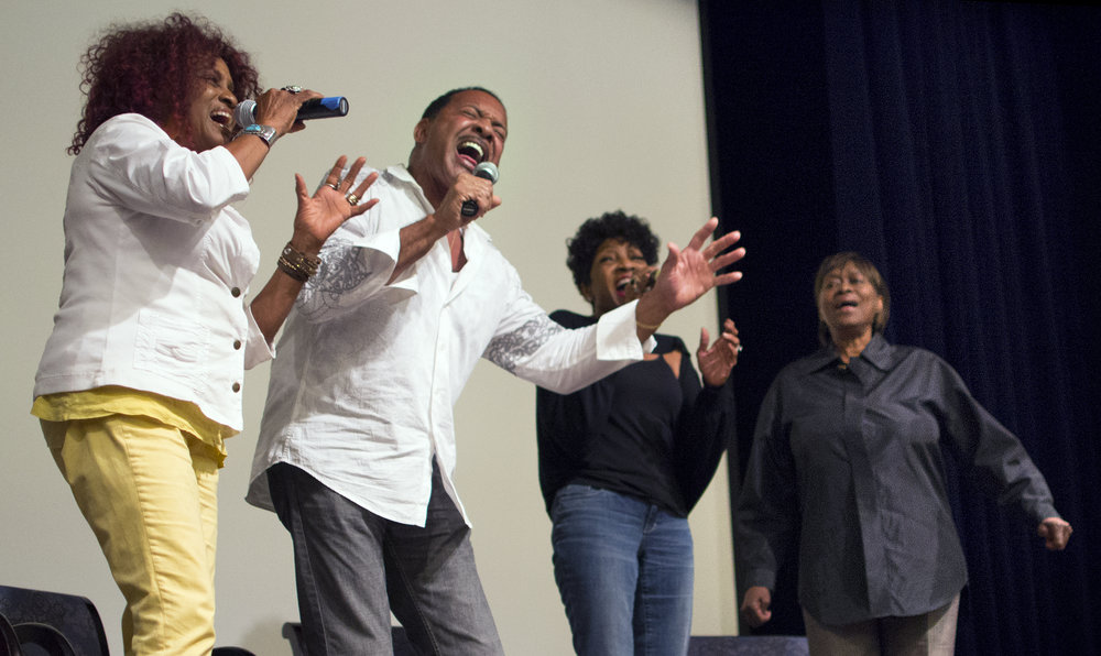 "Julia Waters, left, Orin Waters, Maxine Waters, and Claudia Lennear sing ""Love Lifts Us Up Where We Belong"" Tuesday evening at Rose Hills Theater on the Pomona College campus. The performance followed a screening of the Academy Award winning film, ""20 Feet From Stardom"" that featured the Waters siblings and Ms Lennear. The film examines the lives of backup musicians during the 1960 and 1970s."
