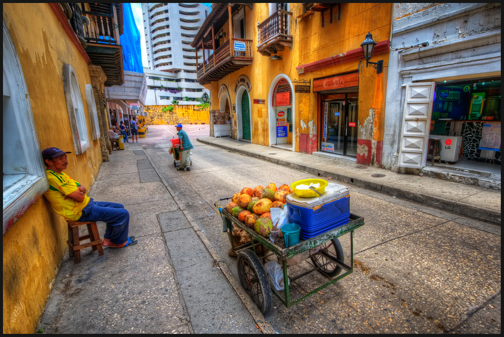 A fruit-seller in Cartagena de las Indias, Colombia. By Pedro Szekely. Available here.