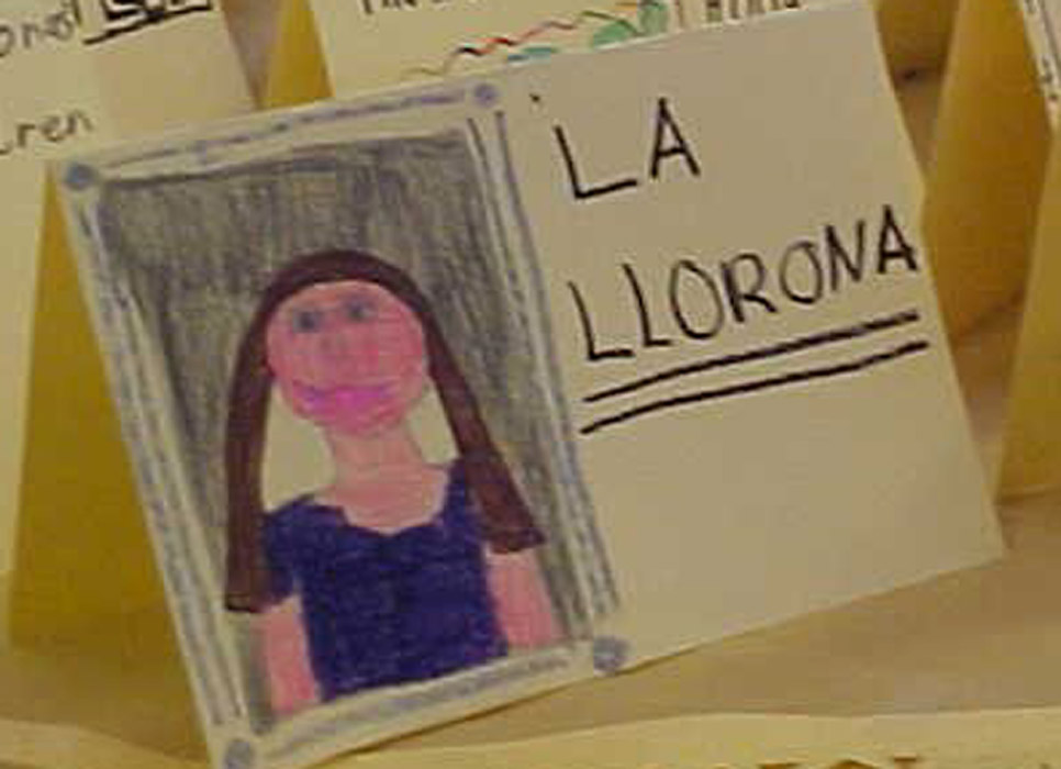 An image of La Llorona as drawn by a schoolchild. The above image is related to a literary altar produced for El DIa de los Muertos; however, we tell a Colombian La Llorona tale in the episode. Source: Garlondcannon, available here.