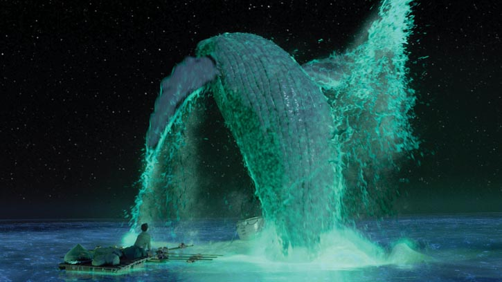A scene from the film Life of Pi in which a whale breaches from the sea at night in a feast of bioluminescent plankton. Peter Sorel. Courtesy of 20th Century Fox./Photo by Macarena Yanez