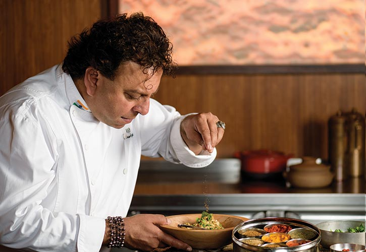 Vikram Vij adds a dash of cumin and magic at his restaurant Vij's in Vancouver.