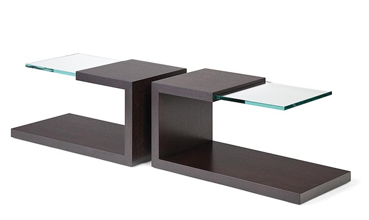 Walnut and ¾ inch thick glass make for intricate end tables, her design.