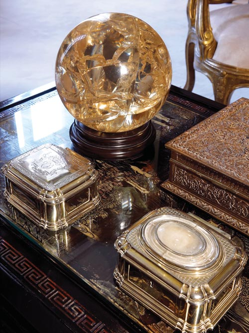A crystal ball and gold boxes gifted by England's Duke of Westminster.