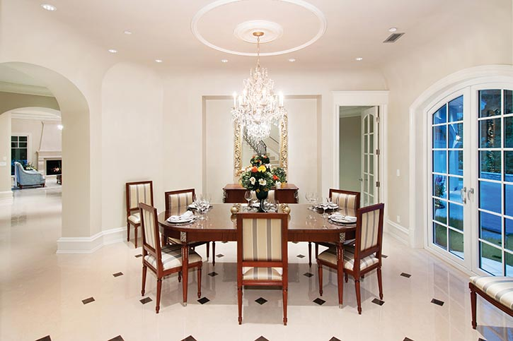 Creamy white paints the formal dining room immaculate and serene.