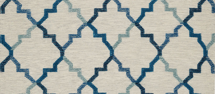 Soumak Area Rug, $699  Handwoven 100 percent new wool rug weaves vibrancy into your home. In neutral gray with classic blue-accented patterns.