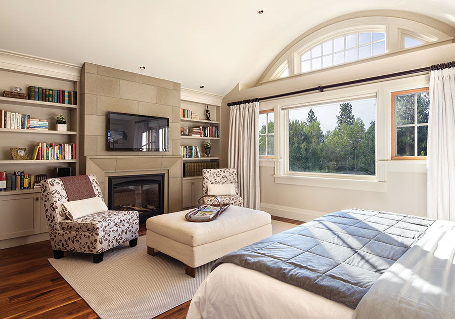 A concrete tile surround gives the fireplace in the master bedroom presence.