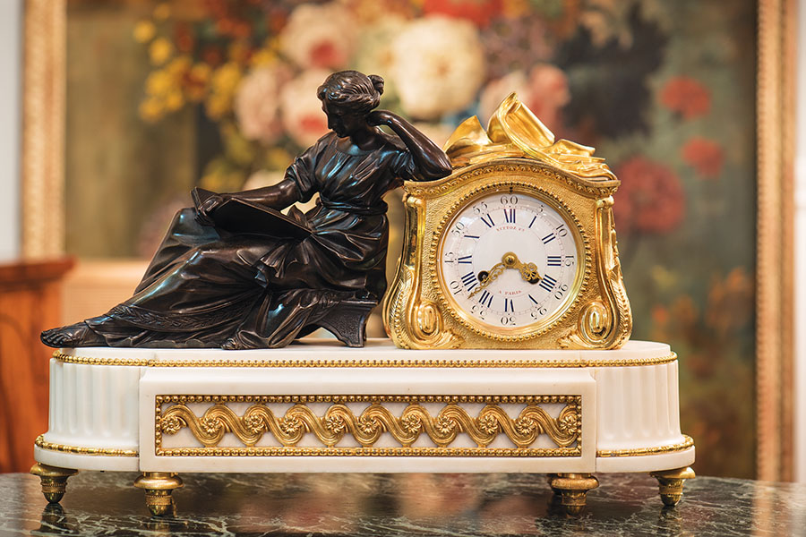 Pendulum a la Geoffrin: A white marble and bronze mantle clock depicting an allegorical portrait of the French salon proprietor Madame Geoffrin.