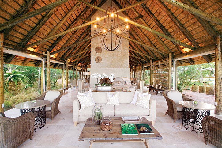Communal lounges nestled under vaulted thatched roofs provide comfortable sofas to sink into while bird watching.