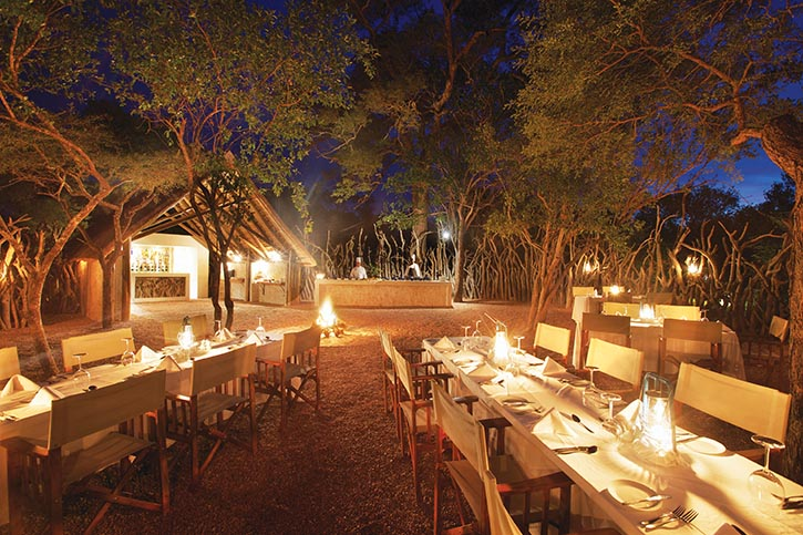 Evening meals are enjoyed seated around a roaring fire in the Rhino Boma.
