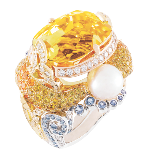 "Van Cleef & Arpels Palais de la Chance Collection ""Carpes Koi"" Ring A 28.67-karat cushion-cut yellow sapphire resembles a golden Koi, breaching the surface of sapphire, diamond, mandarin garnet and pearl water. It brings good luck and good fortune to its wearer. At Birks, www.vancleefarpels.com"