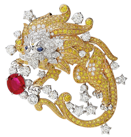 "Van Cleef & Arpels Palais de la Chance Collection ""Zodiac Leo"" Clip Inlaid with white diamonds, yellow diamonds and sapphires, this cute little lion is playing with the 3.09-carat oval-cut ruby in front of it. At Birks, www.vancleefarpels.com"