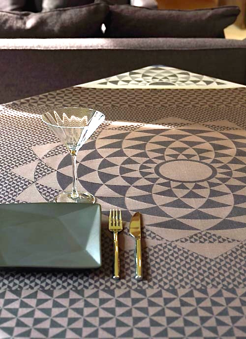 Sophisticated brown in fine patterns will make a statement when guests arrive, then blend in with intellectual conversation. This tablecloth provides avant-garde accents and eye-catching movement that can become background or foreground depending on nearby decor.