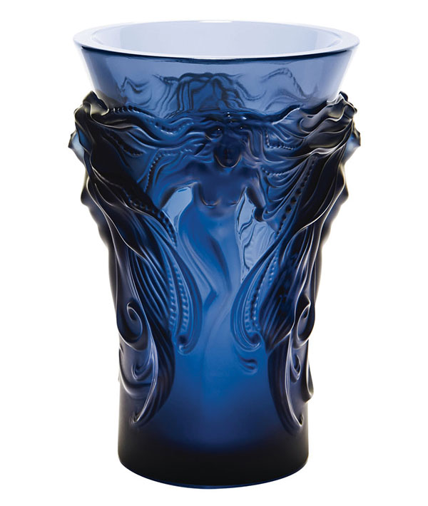 Lalique Midnight Blue Crystal Fantasia Vase, Price Upon Request This mythic vase depicts four Venus figures emerging from a cloud. When light hits the cobalt crystal relief surfaces, varying shades of blue are revealed. At Atkinson's, Atkinsonsofvancouver.com