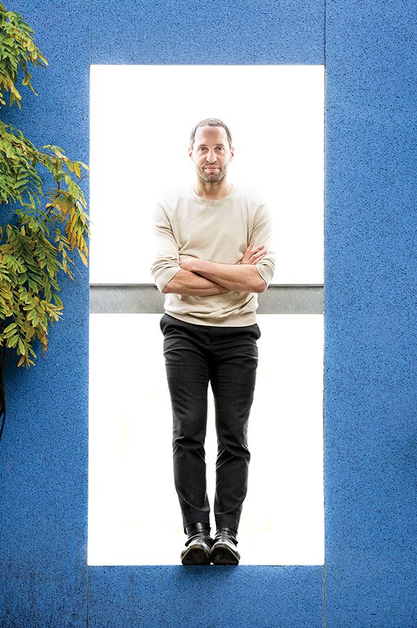 Omer Arbel, creative director of Bocci, basks in autumn light at his office in Vancouver, BC./Photo by Milos Tosic