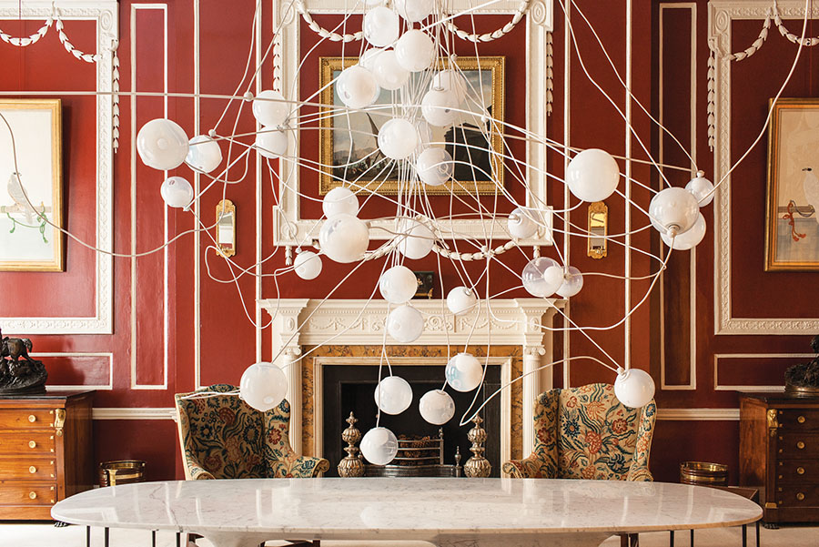 Chandelier from Collection 28 at Mallett Antiques, made of opaque milk glass and low voltage xenon or LED lamps.