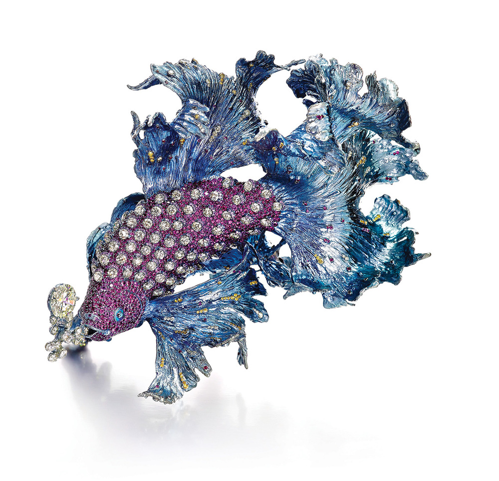 Gleams of Waves brooch featuring yellow diamonds at 6.68ct each, rubies and pink sapphires.
