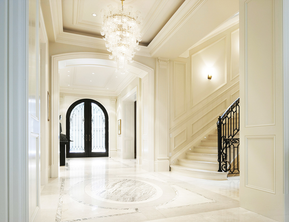 the foyer is resplendent in Persian limestone, Crema Marfil marble and intricate onyx inlay.