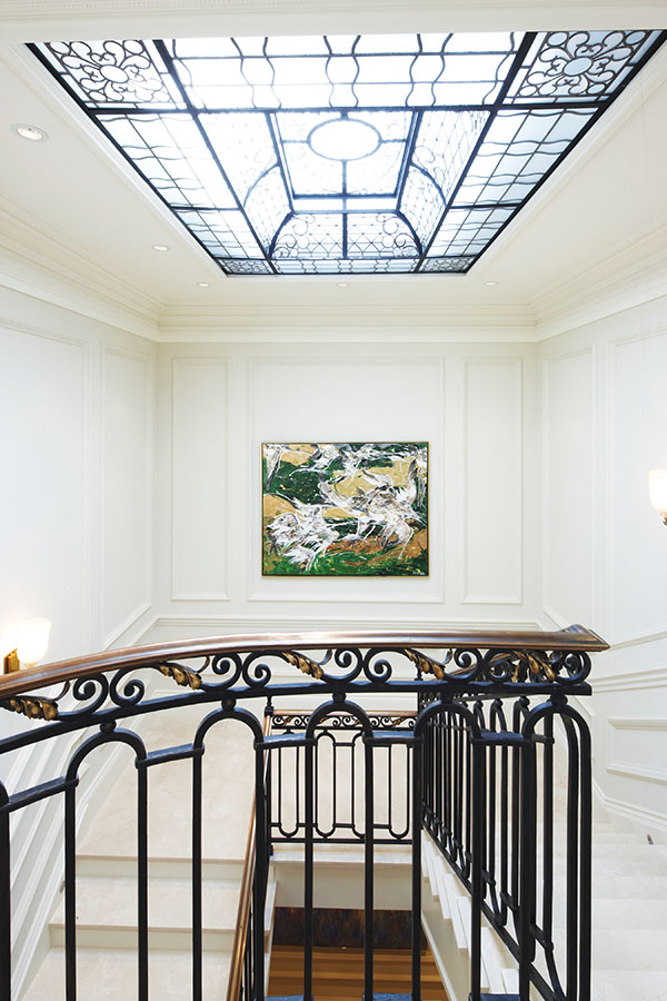 Wrought iron inserts add an element of Art Deco to the third floor skylight.
