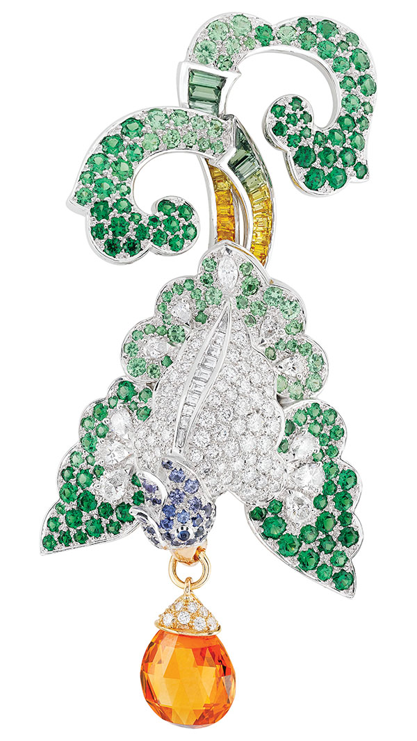 Oiseau Oriental Clip from the Birds of Paradise Collection, Van Cleef & Arpels 5.46-carat briolette-cut mandarin garnet, multicoloured sapphires, tsavorite garnets and diamonds set in 18K white and rose gold. www.vancleefarpels.com