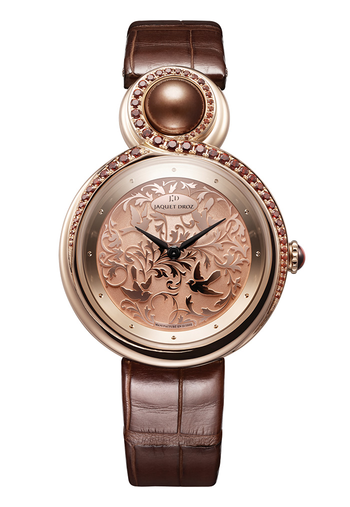 Lady 8 Art Deco Watch, Jaquet Droz   Dome-shaped red gold dial, 18K red gold case set with brown garnets. Brown pearl at 12 o'clock, brown garnet cabochon. Self-winding mechanical movement, 35 mm, with a power reserve of 68 hours. jaquet-droz.com, at Lugaro Jewellers, 604 925 2043