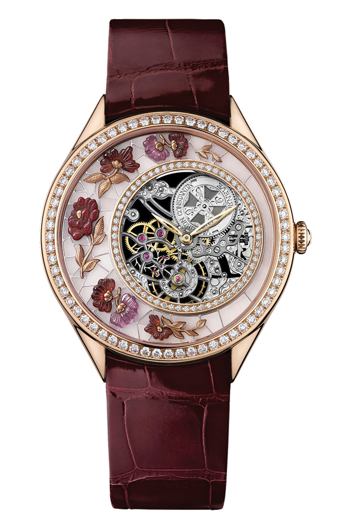 Métiers d'Art Fabuleux Ornements Chinese Embroidery Watch, Vacheron Constantin Artistic cloisonne dial carpeted with flowers in rubies, cuprites and garnets. 18K pink gold with 85 diamonds (2.7 cts). Limited edition 20 pieces. 37mm, open-working ultra-slim Calibre 1003. Manual-winding mechanical.  vacheron-constantin.com, At Palladio, 604 685 3885
