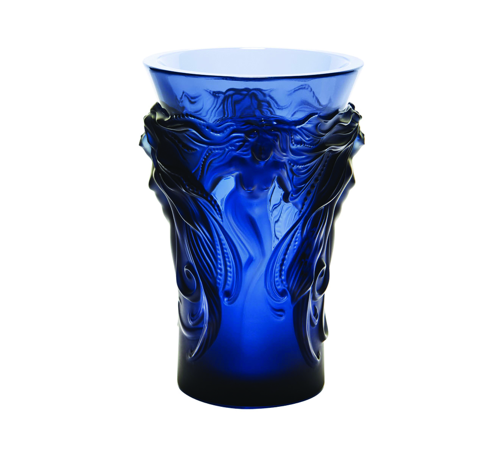 Lalique Midnight Blue Crystal Fantasia Vase USD$1,500  This mythic vase depicts four Venus figures emerging from a cloud. When light hitsthe cobalt crystal relief surfaces, varying shades of blue are revealed.  At Atkinson's of Vancouver