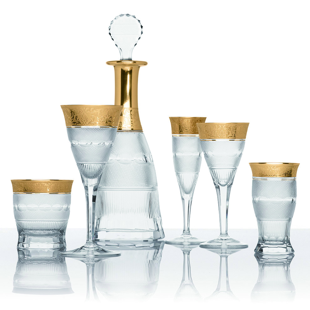 Moser Splendid Gold Tableware Collection Price Upon Request This opulent setting makes any party table a royal occasion. Channel the luxury of the czar with Moser's mouth blown glassware in 24K gold.   At Atkinson's of Vancouver