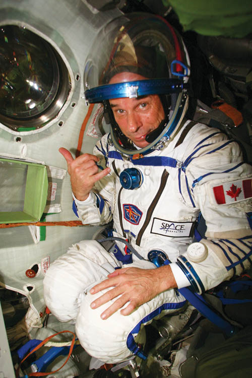 Guy Laliberte, Canadian and founder of Cirque du Soleil, traveling beyond our atmosphere with the astronauts.