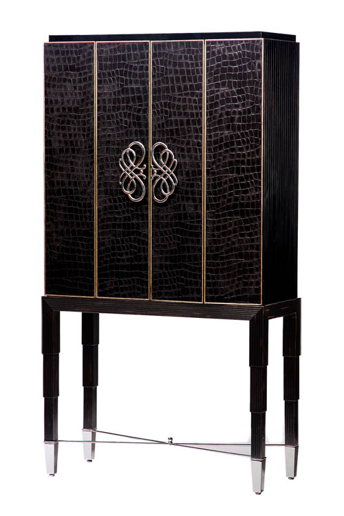 Marge Carson Bossa Nova TV Cabinet, $7,259 This cabinet embraces feminine curves and linear masculine lines. Burnished silver trim, manifold infinity-shaped polished nickel handle present an embellished air. At Paramount Furniture, 604 273 0155 paramountfurniture.ca