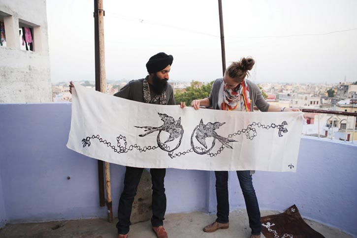 Ahluwalia and Weston hold up a handmade House of Waris scarf, one of the many items available at the pop-up shop at Holt Renfrew.