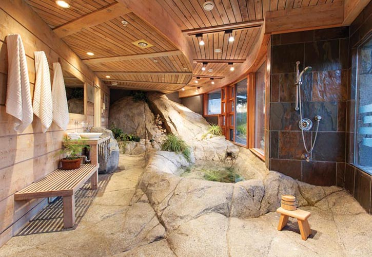 "This private spa area utilizes the original stone slope that first piqued the owner's passion for the property. ""Customized"" doesn't begin to describe the unparalleled craftsmanship and unique problem solving the architect and contractors carried out. The result is a journey into an enchanted forest."