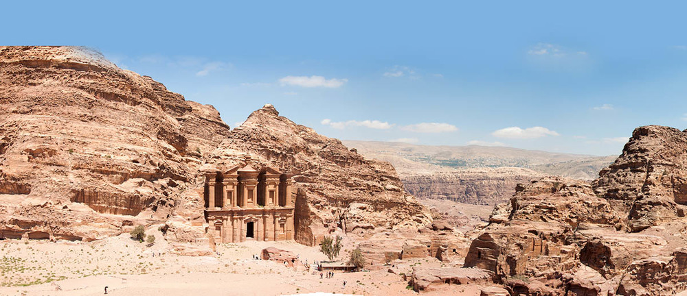 """The largest monument at Petra, the """"Monastery"""" rests high above the city. When the sun sets, a shadow of a lion's head (the sacred animal of the Nabateans' goddess) is recreated on the rocks opposite."""