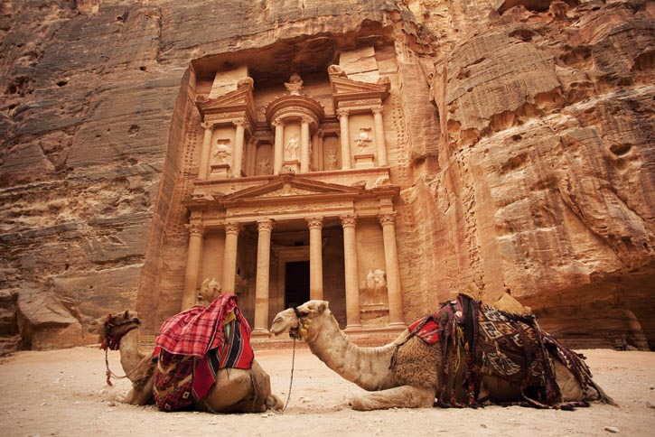"""After passing through the city's narrow entryway, the intricately carved """"Treasury"""" suddenly bursts into view. It's believed the stone urn crowning Petra's most famous monument once hid treasure."""