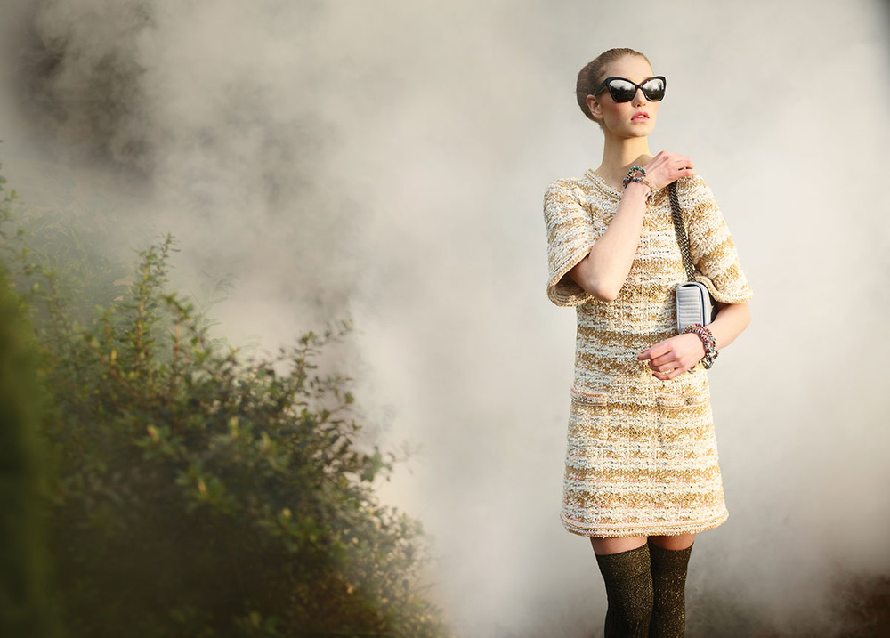 Moment by Moment Be the vision that makes time stand still  Emerge from a dream state  Just in time to meet your ideal match  Viscose A-line front-pockets dress Knit kidskin open shoes Tweed metal chain-link bracelet Acetate sunglasses Calfskin flap bag  All by Chanel
